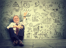 Senior business man elderly teacher pointing at new project calculations Stock Photo