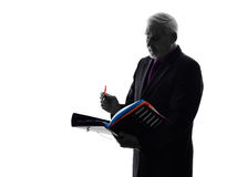 Senior business man filing files documents silhouette Royalty Free Stock Photography