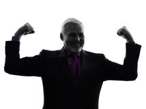 Senior business man flexing muscles strong silhouette Royalty Free Stock Photography