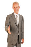 Senior business man giving hand Stock Images