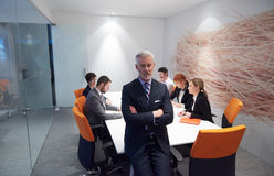 Senior business man with his team at office Stock Photos