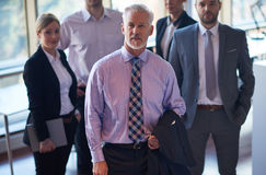 Senior business man with his team at office Stock Photography