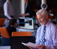 Senior business man with his team at office Royalty Free Stock Photos