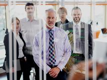 Senior business man with his team at office Royalty Free Stock Images
