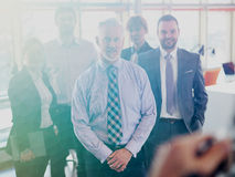 Senior business man with his team at office Royalty Free Stock Photo