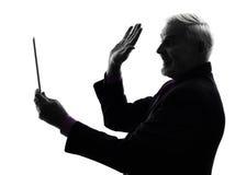 Senior business man holding digital tablet saluting silhouette Stock Photography
