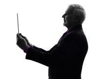 Senior business man holding digital tablet silhouette Stock Photos