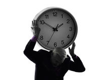 Senior business man holding time clock silhouette Stock Photography