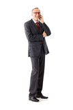 Senior business man isolated, calling Royalty Free Stock Photography