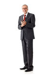 Senior business man isolated, writing sms Royalty Free Stock Image