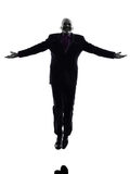 Senior business man jumping arms outstretched silhouette Royalty Free Stock Image