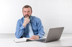 Senior business man with laptop Stock Images