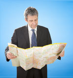 Senior business man looking into map Royalty Free Stock Photos