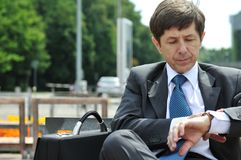 Senior business man looking at watches Stock Photos