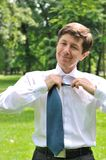 Senior business man loosening tie Royalty Free Stock Photo