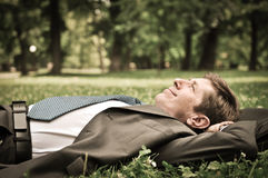 Senior business man lying in grass Stock Images