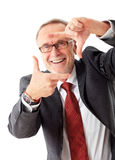 Senior business man makes a sign with his hands Stock Images