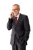 Senior business man with mobilephone und a pair of glasses Royalty Free Stock Images