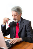 Senior business man with pc Stock Photos