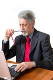 Senior business man with pc Stock Photos
