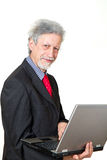 Senior business man with pc Royalty Free Stock Images
