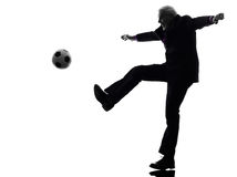 Senior business man playing soccer silhouette Royalty Free Stock Image