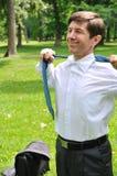 Senior business man putting off tie Stock Photo