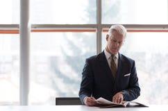 Senior business man reading magazine Stock Photography
