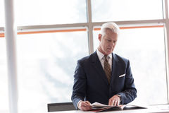 Senior business man reading magazine Stock Photo
