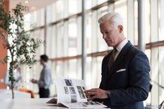 Senior business man reading magazine Stock Photos
