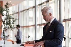 Senior business man reading magazine Stock Photo