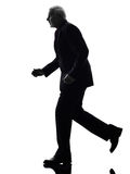Senior business man running silhouette Stock Photography