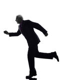 Senior business man running silhouette Stock Image