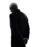 Senior business man sad rear view silhouette. One Caucasian senior business man sad rear view silhouette White Background royalty free stock images