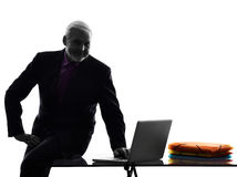 Senior business man silhouette computing Royalty Free Stock Photography