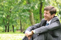 Senior business man siting in park Royalty Free Stock Image