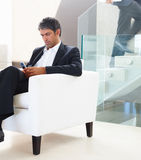 A senior business man sitting in the office Royalty Free Stock Image