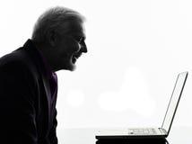 Senior business man smiling computing laptop Royalty Free Stock Photography
