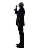 Senior business man smoking electronic e-cigarette silhouette Royalty Free Stock Photo