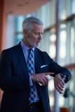 Senior business man talk on mobile phone Stock Photos