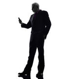 Senior business man on the telephone angry silhouette Royalty Free Stock Image