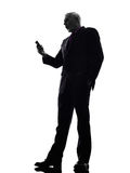 Senior business man on the telephone angry silhouette Stock Photography