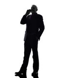 Senior business man on the telephone smiling silhouette Royalty Free Stock Photos