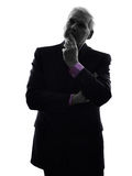 Senior business man thinking silhouette Stock Photo