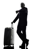 Senior business man traveler traveling waiting silhouette Stock Photos