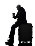 Senior business man traveler traveling waiting silhouette Stock Photo