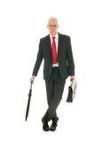 Senior business man with umbrella Stock Images