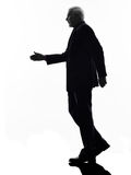 Senior business man walking handshake silhouette Stock Image