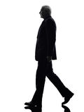 Senior business man walking silhouette Royalty Free Stock Images