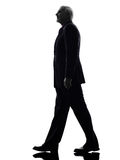 Senior business man walking silhouette Stock Image